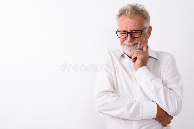 Estúdio disparado do homem farpado superior triste que pensa ao gritar com fotografia de stock royalty free