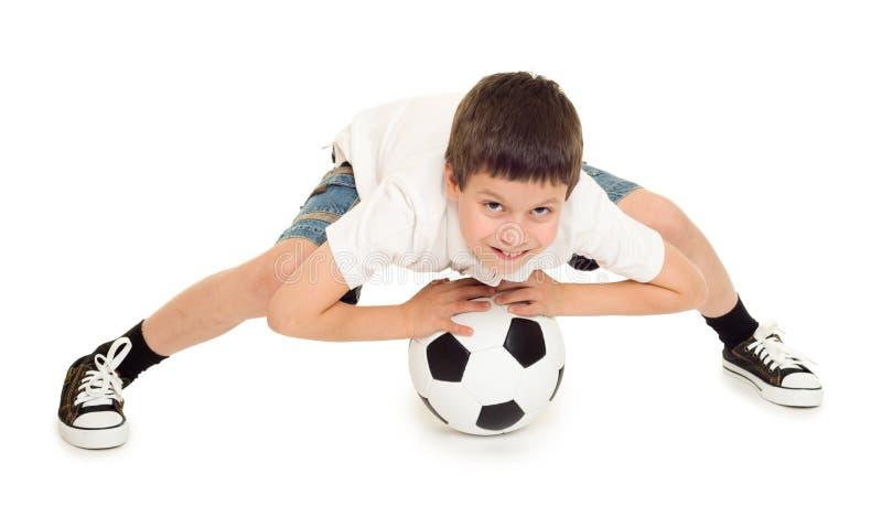 Estúdio do menino do futebol isolado fotos de stock royalty free