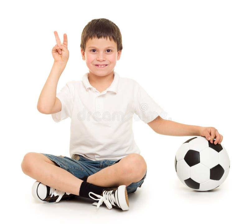 Estúdio do menino do futebol isolado imagens de stock royalty free