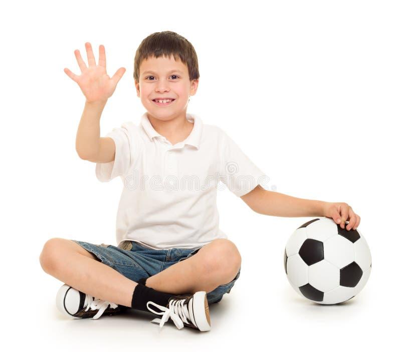 Estúdio do menino do futebol isolado fotos de stock