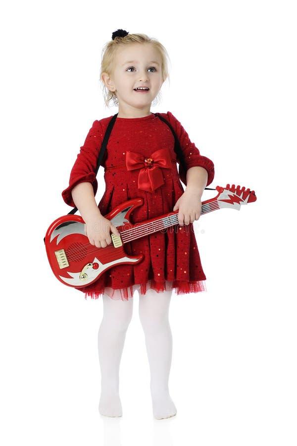 Est-ce que je peux jouer ma guitare maintenant ? photos libres de droits