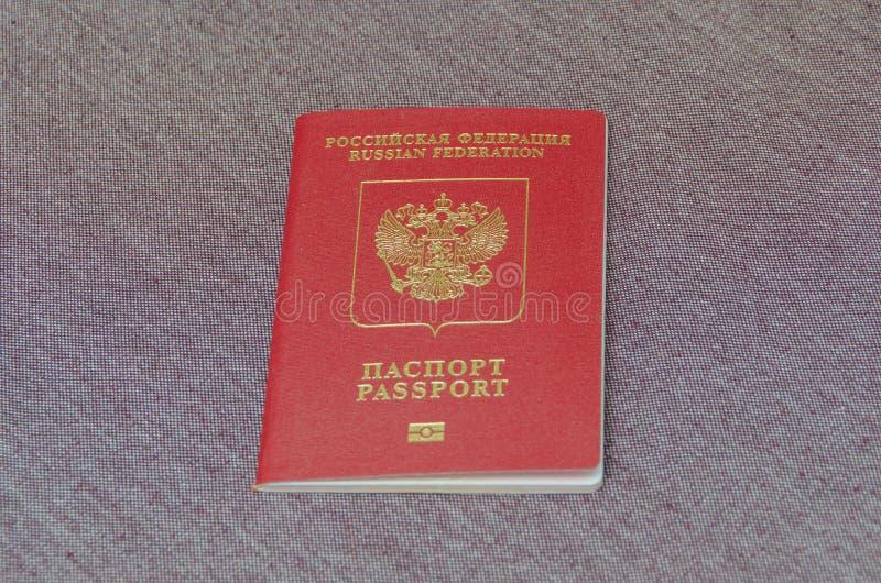 Est le passeport du citoyen du pays, sur un textu de tissu photo stock