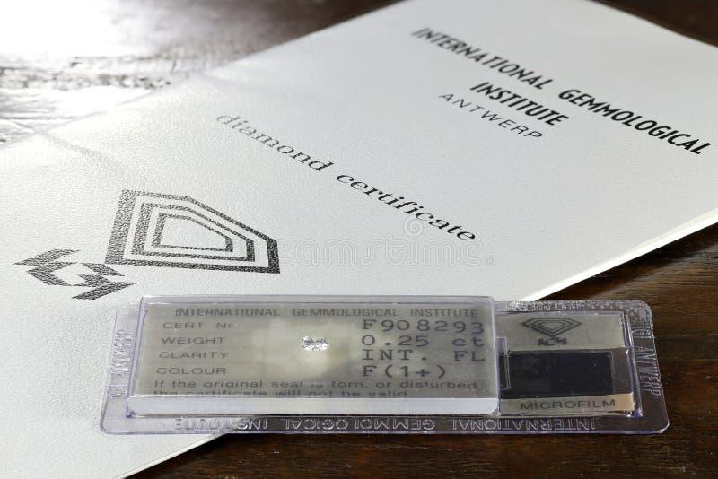 IGI certified 0.25 ct brilliant cut diamond. Established in 1975, International Gemological Institute IGI is the largest independent gemological laboratory royalty free stock photo