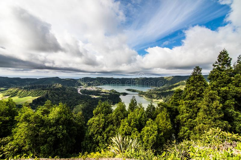 Establishing shot of the Lagoa das Sete Cidades lake taken from Vista do Rei in the island of Sao Miguel, The Azores, Portugal. Th stock photos