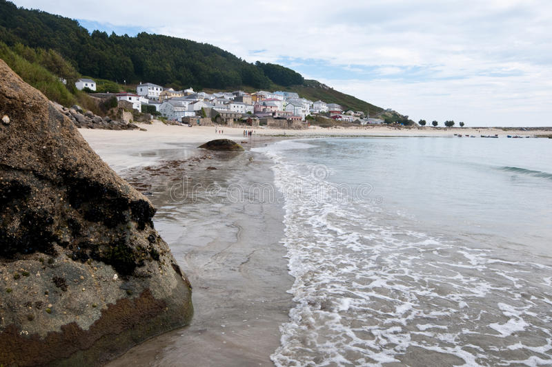 Estaca de Bares in Galicia, beach and boats. Small fishing village of Estaca de Bares at the northernmost point of Spain. Beach, houses, fishing boats and dunes stock images