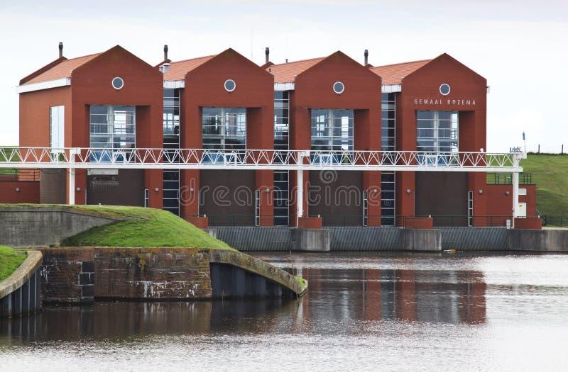 Estación holandesa Rozema del bombeo de agua de Termuntenzijl foto de archivo