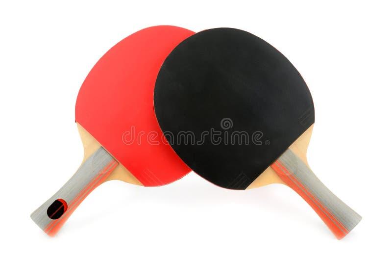 Estafas del ping-pong aisladas en el fondo blanco foto de archivo