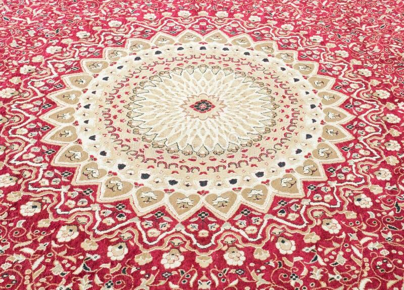 Estampado de flores en la alfombra de las lanas fotos de archivo