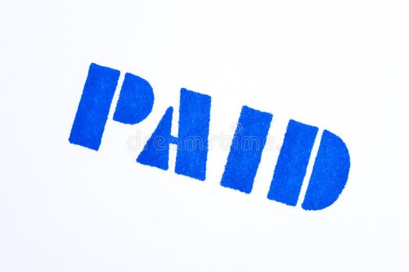 Estampille payée bleue sur le blanc photos libres de droits