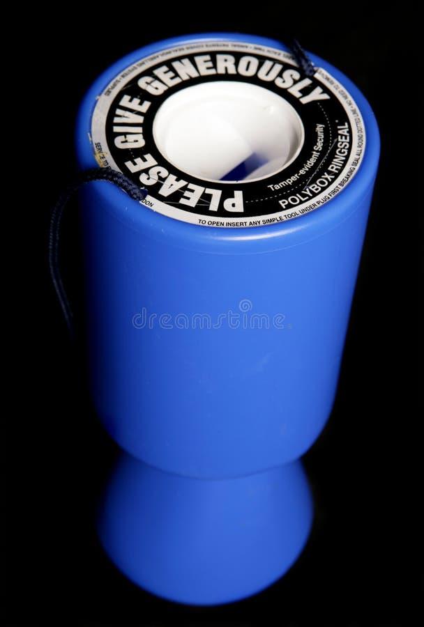 Estanho azul da coleção da caridade fotografia de stock royalty free