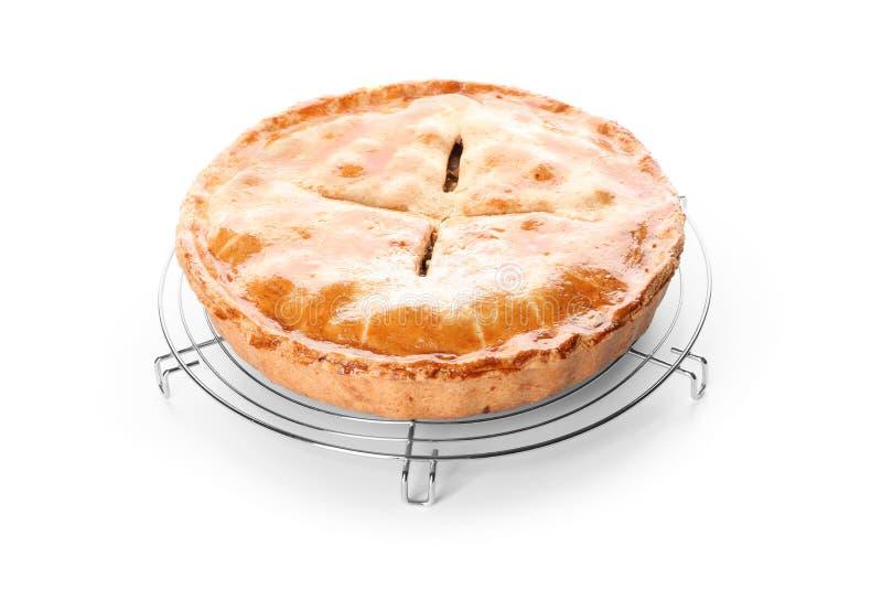 Estante de enfriamiento con la empanada de manzana deliciosa en el fondo blanco foto de archivo libre de regalías