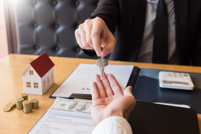 Estate agent giving house keys customer sign agreement property for sale, Buying and selling homes concept.  royalty free stock images