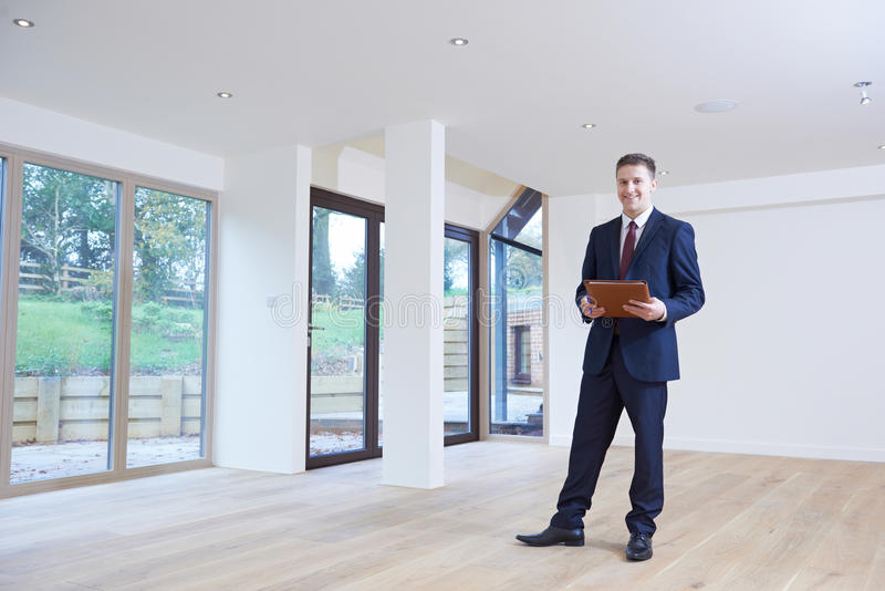 Estate Agent Looking Around Vacant Property For Valuation. Estate Agent Looks Around Vacant Property For Valuation stock image