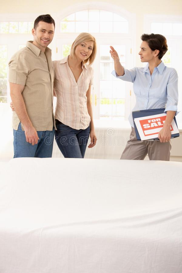 Estate Agent Showing Around Couple Royalty Free Stock Image