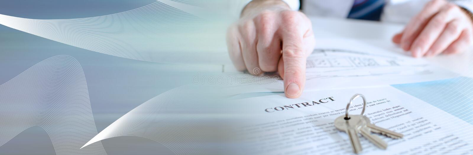 Estate agent showing a contract (Lorem Ipsum Text); panoramic banner. Estate agent showing a contract with his finger (Lorem Ipsum Text);  panoramic banner stock photo