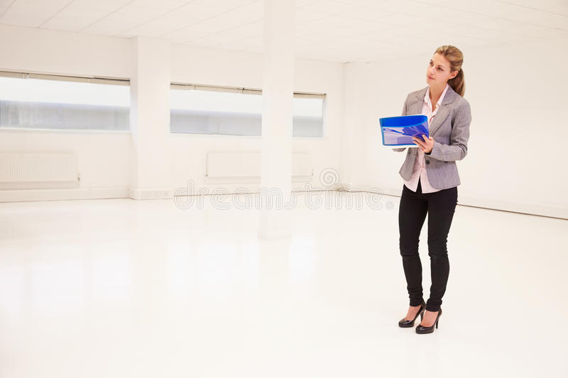 Estate Agent Writing Details For Empty Office Space royalty free stock photos