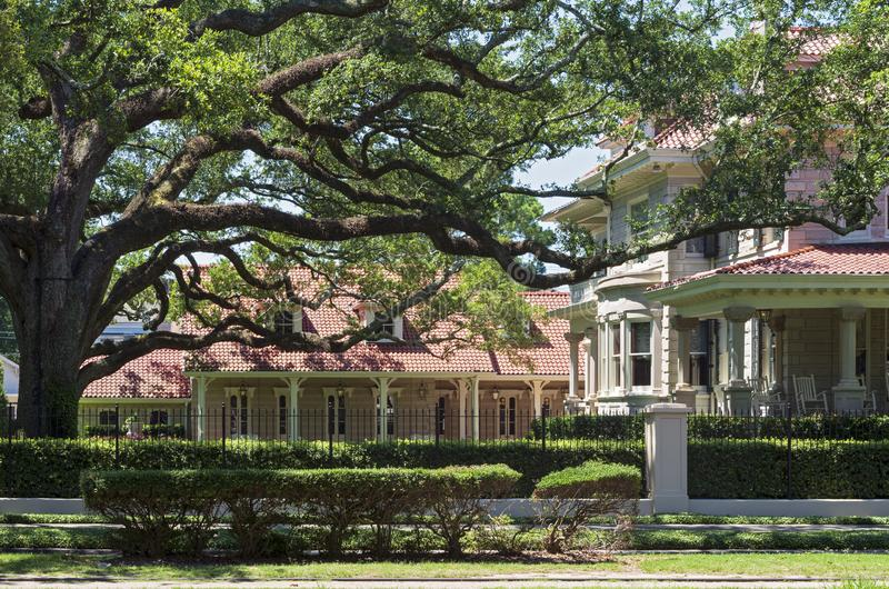 Estate and Carriage House of Landmark Home in New Orleans. Landmark estate facace courtyard and carriage house in historic area of new orleans royalty free stock image