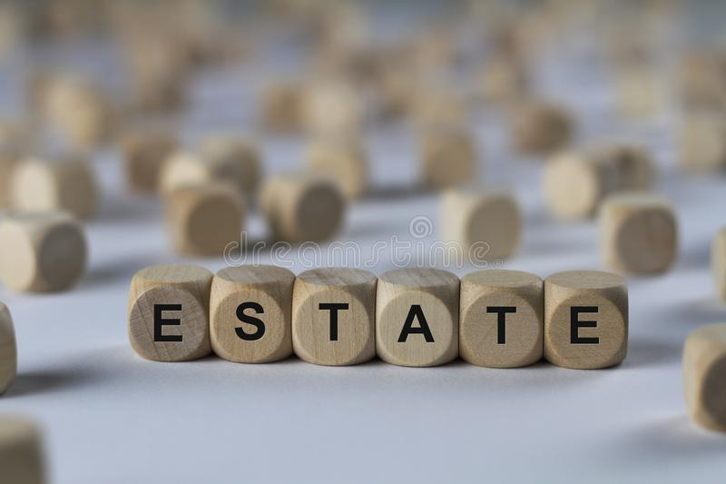Estate - cube with letters, sign with wooden cubes. Estate - wooden cubes with the inscription `cube with letters, sign with wooden cubes`. This image belongs to royalty free stock image
