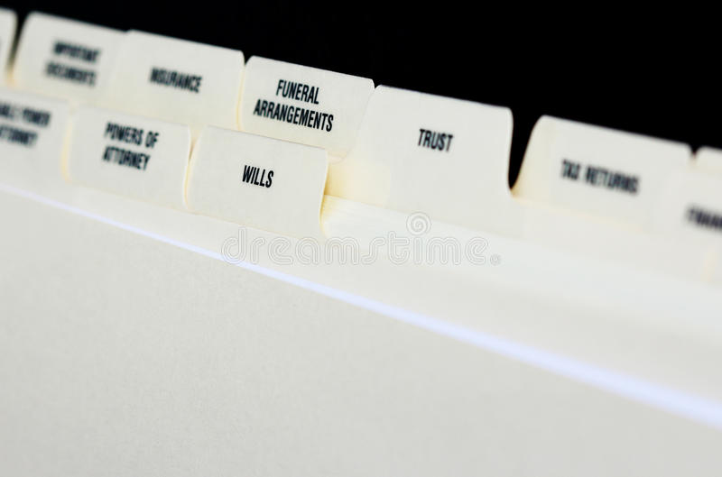 Estate Planning. File tabs of estate planning document with focus on wills and funeral arrangements royalty free stock photo