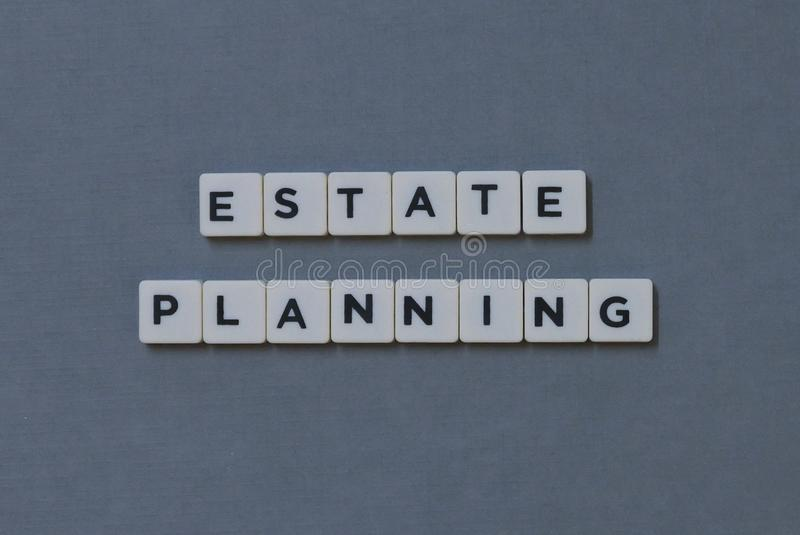 ' Estate Planning ' word made of square letter word on grey background. Notebook, strategy, business, wealth, money, job, management, future, success royalty free stock image