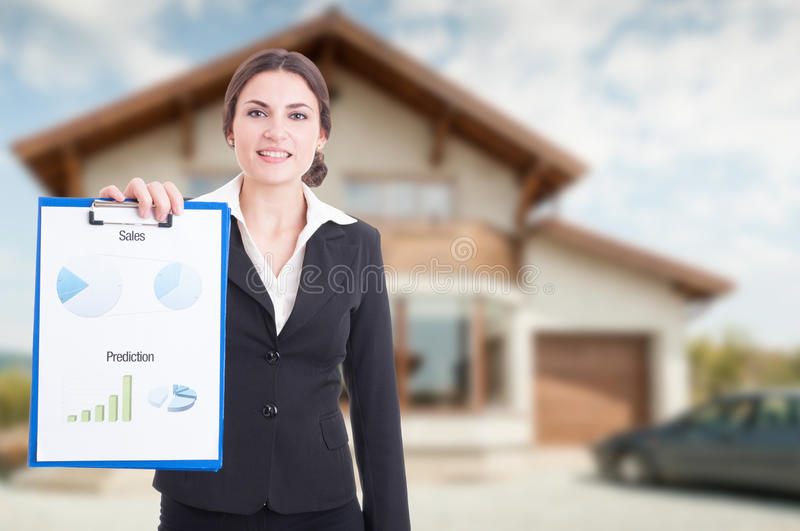 Estate profit concept with female realtor stock photography