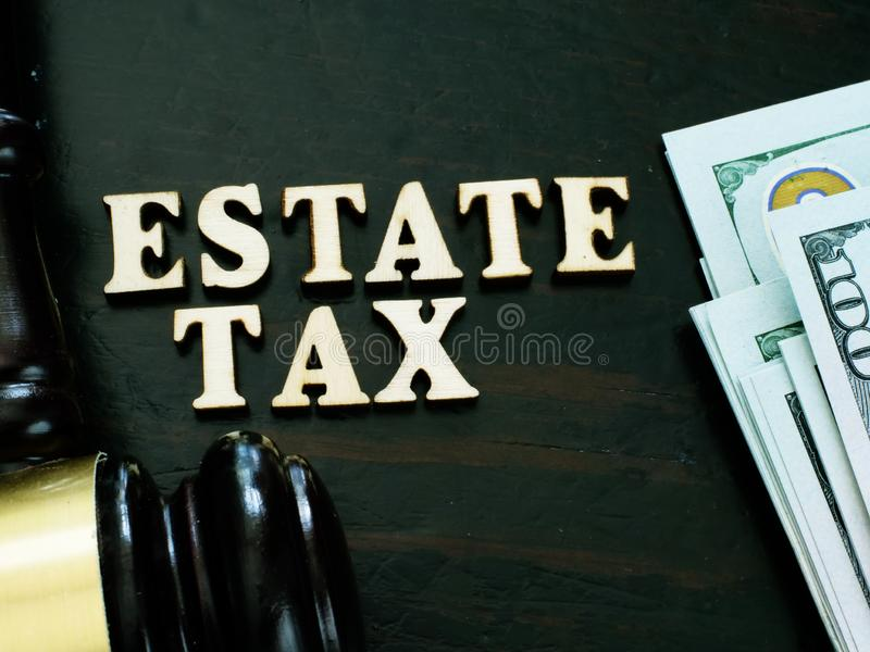 Estate tax from letters and gavel. Estate tax from wooden letters and gavel royalty free stock photography