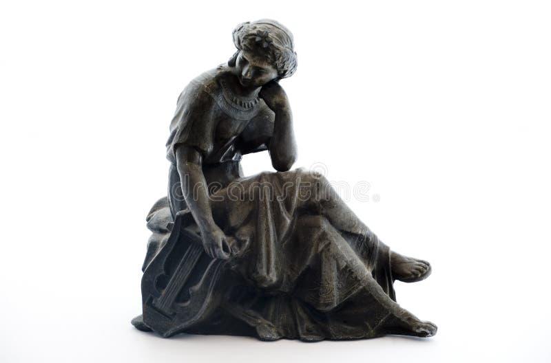 Estatua antigua del metal en el fondo blanco imágenes de archivo libres de regalías