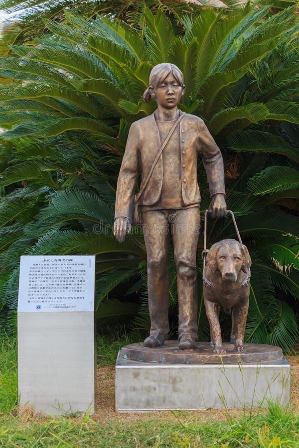 Estatua ciega de la muchacha y del perro en la estación de Nagasaki fotos de archivo libres de regalías