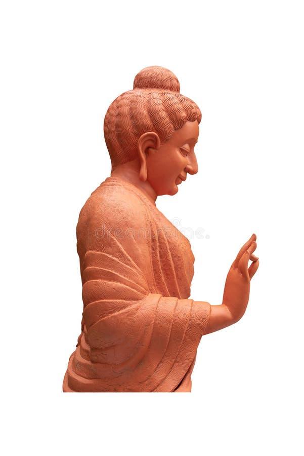 Estatua de Brown de la vista lateral de Buda en el aislante del templo en el fondo blanco fotografía de archivo libre de regalías