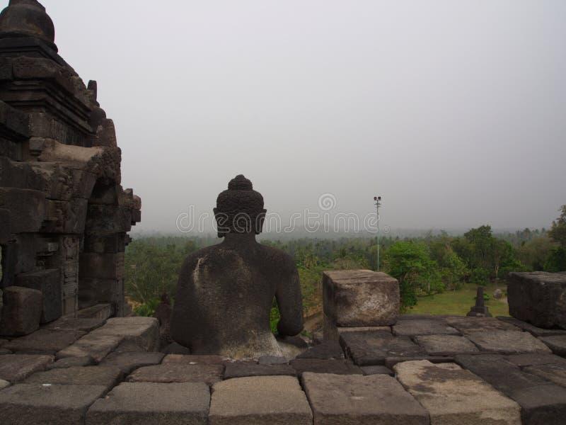 Estatua de Buda en Borobudur en la ciudad de Yogyakarta Viaje en Indone fotos de archivo