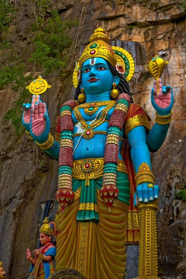 Estatua de dios de Krishna Hindu en las cuevas Gombak Selangor Malasia de Batu fotografía de archivo libre de regalías