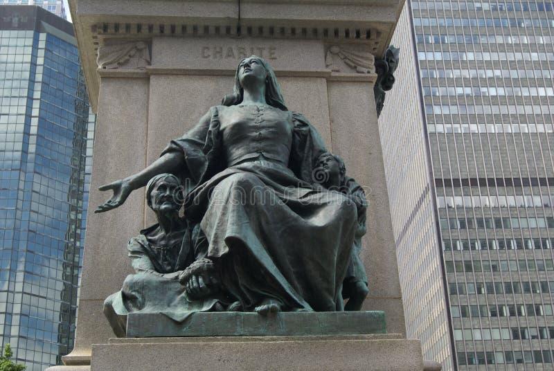 Estatua de la caridad, detalle de Ignace Bourget Monument en Montreal, Quebec, Canadá foto de archivo