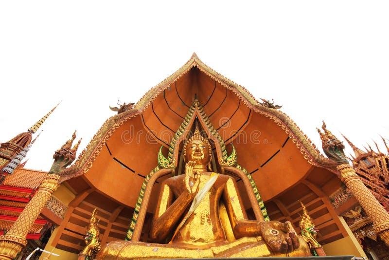 Estatua de oro del monje budista foto de archivo libre de regalías