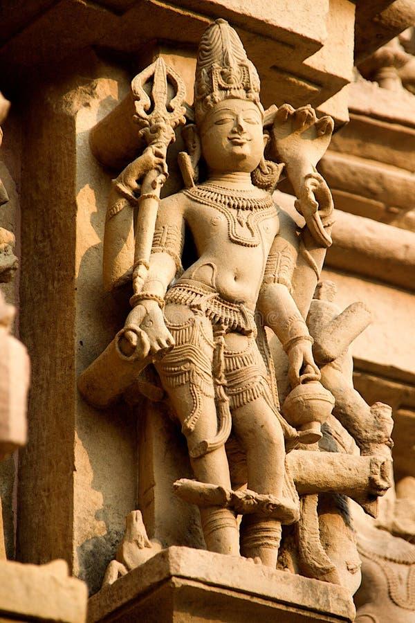 Estatua de piedra en el templo Jain, Khajuraho imagenes de archivo