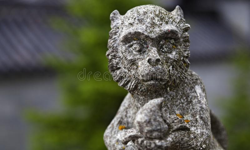 Estatua de piedra religiosa del mono fotografía de archivo