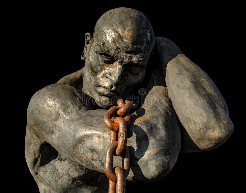 Estatua de un esclavo que lleva un barco usando una cadena imagen de archivo