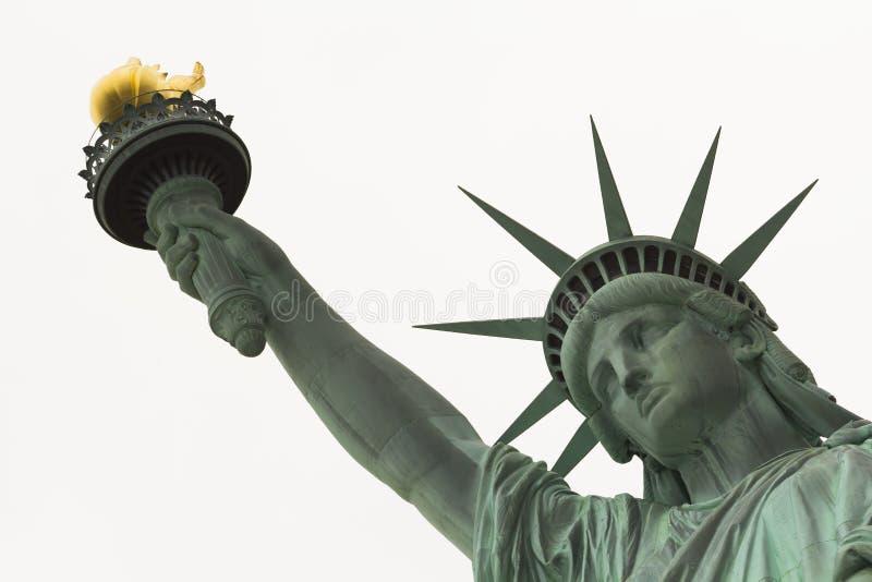 Estatua del cierre de la libertad para arriba en cara y el brazo imagenes de archivo