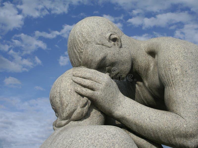 Estatua del padre/de la hija foto de archivo libre de regalías