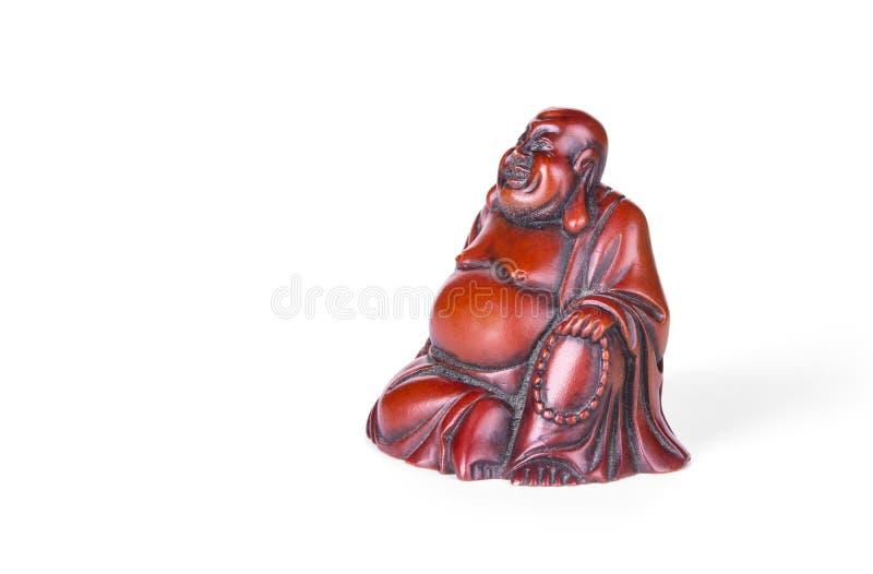 Estatua gorda de Buda en el fondo blanco fotos de archivo