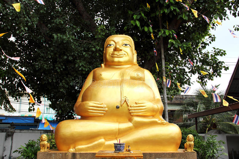 Estatua gorda feliz de oro de Buda fotos de archivo