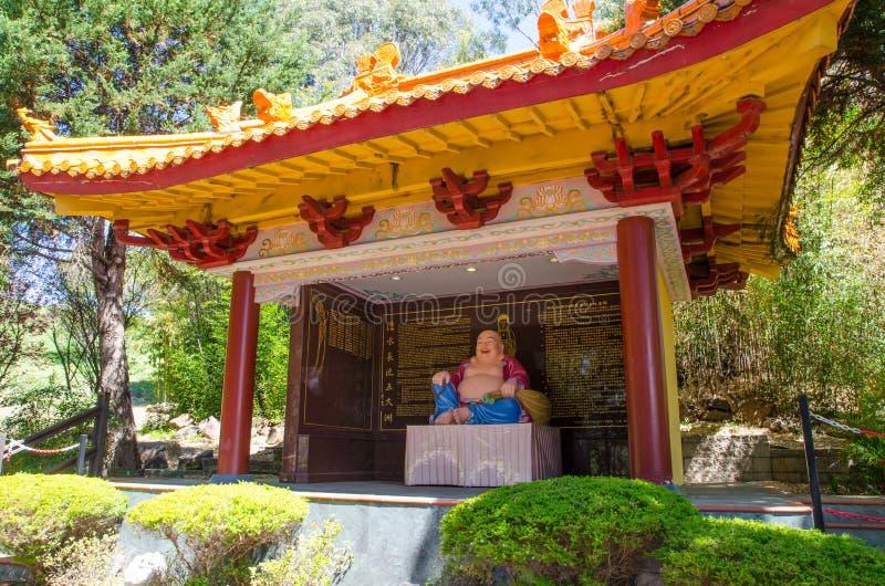 Estatua sonriente de Buda en Nan Tien Temple, Berkeley, Nuevo Gales del Sur imagen de archivo