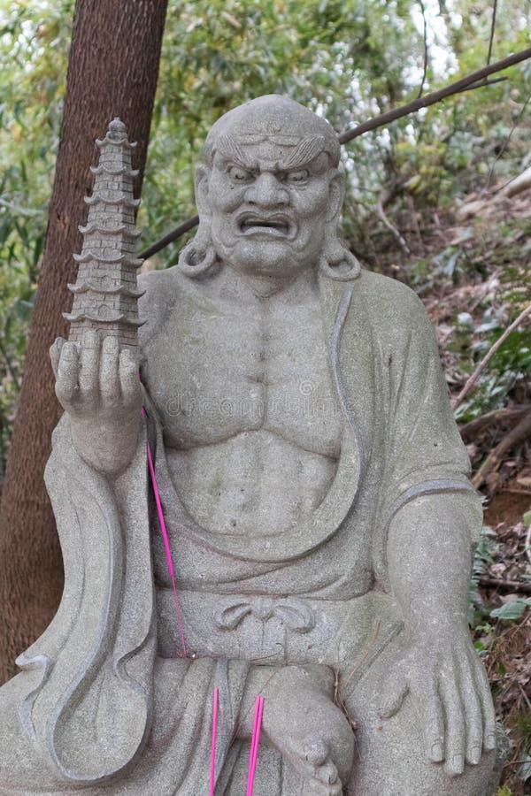 Estatua tallar-grande de piedra venerable dieciocho fotografía de archivo libre de regalías