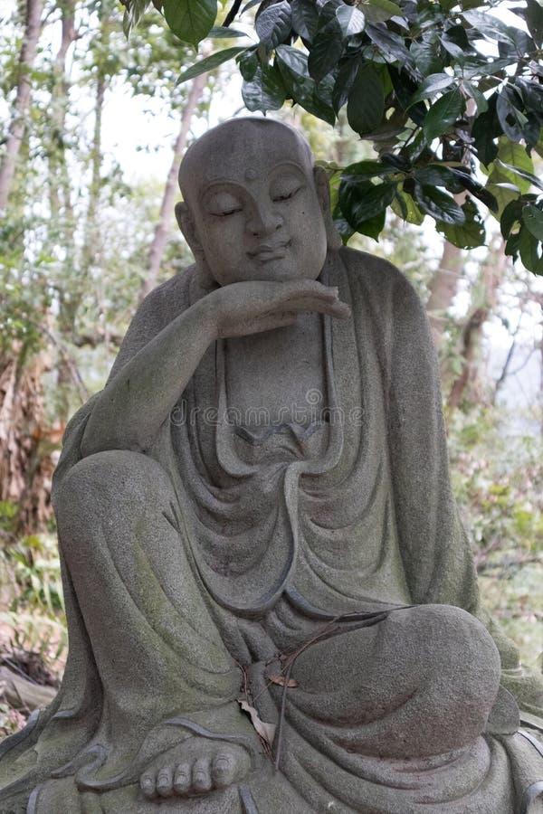 Estatua tallar-grande de piedra venerable dieciocho imagen de archivo