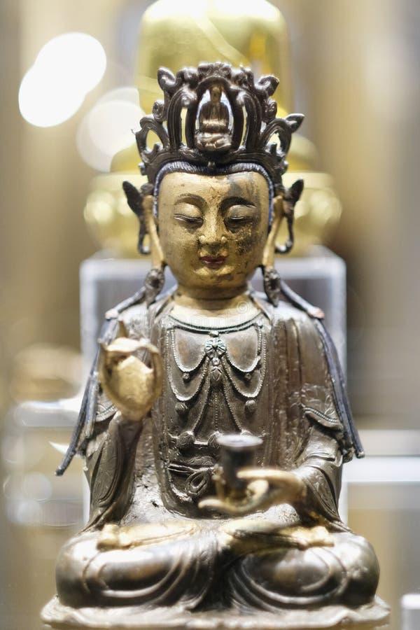 Estatueta da deidade budista oriental imagem de stock