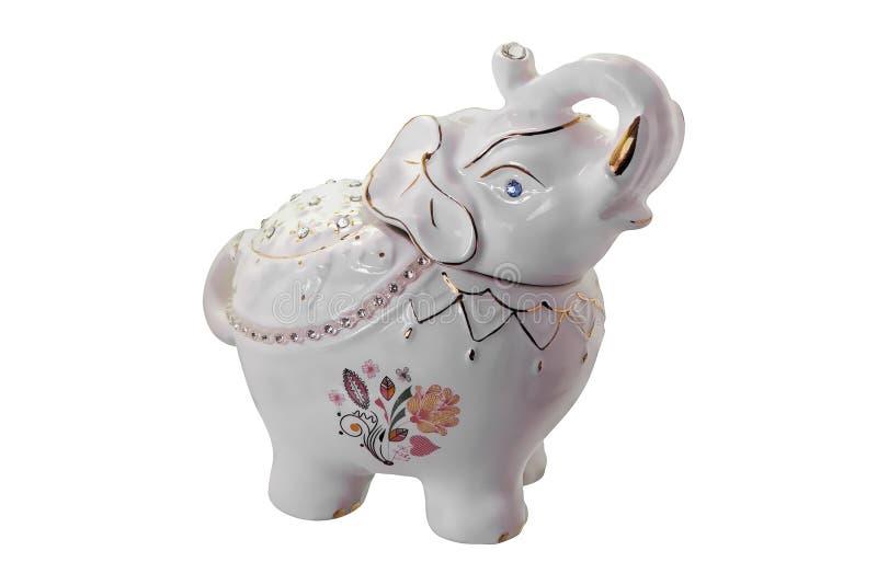 Estatueta da porcelana de um elefante no branco fotos de stock