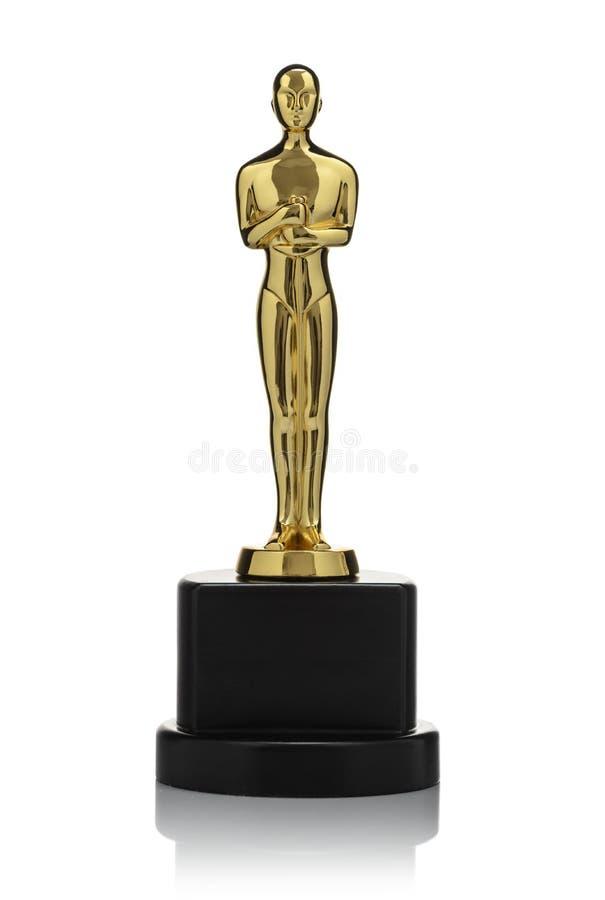Estatueta dourada isolada fotografia de stock