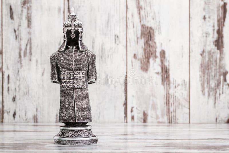 Estatueta religiosa de prata projetada como a armadura imagens de stock royalty free