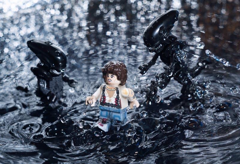 Estatuetas do filme de LEGO Alien imagem de stock