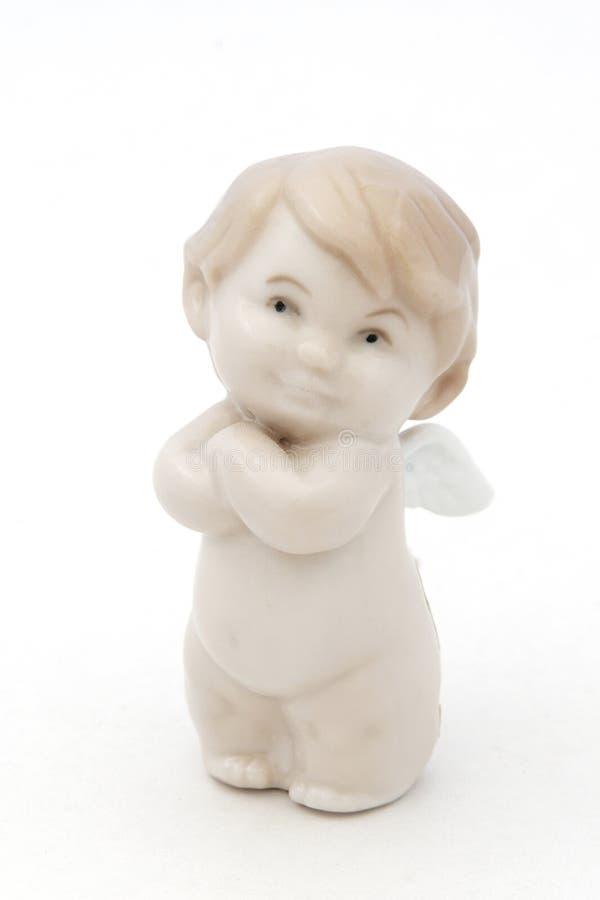 Estatuilla blanca del ángel de la porcelana fotos de archivo