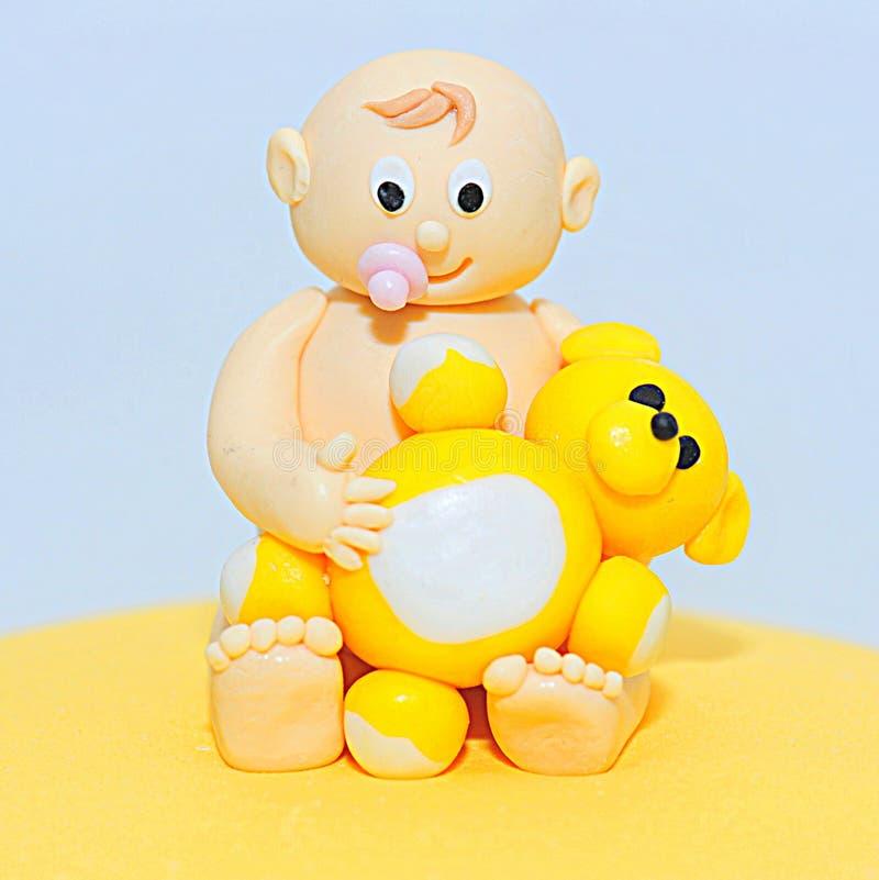 Estatuilla de la pasta de azúcar del tema de la fiesta de bienvenida al bebé para las tortas foto de archivo
